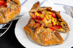 Spicy rye galettes with tomatoes, corn and ricotta Stock Image
