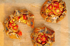 Spicy rye galettes with tomatoes, corn and ricotta Royalty Free Stock Photography
