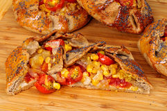 Spicy rye galettes with tomatoes, corn and ricotta Royalty Free Stock Images