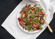 Spicy Salad with dry anchovies. Shiitake mushroom, tomato, onion, celery royalty free stock photo