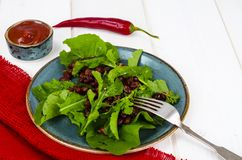 Spicy salad with arugula, beans and chili stock images