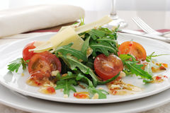 Salad of arugula and cherry tomatoes with parmesan sauce Royalty Free Stock Photography