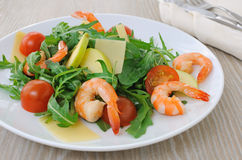 Spicy salad of arugula with cherry tomatoes and shrimp Stock Image
