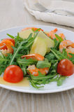 Spicy salad of arugula with cherry tomatoes and shrimp Royalty Free Stock Image