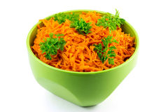 Spicy salad of grated carrots in bowl, isolated on white background Stock Photography