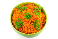 Spicy salad of grated carrots in bowl, isolated on white background Stock Images