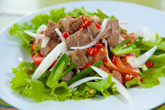 Spicy salad with pork and green herb Stock Images