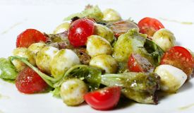 Spicy salad with quail eggs and cherry tomatoes Royalty Free Stock Photography