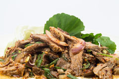 Spicy salad of roasted beef , Thai style cuisine. Nuea yang nam tok, sliced grilled beef in a spicy dressing with shallots and mint is most often made with Royalty Free Stock Photography