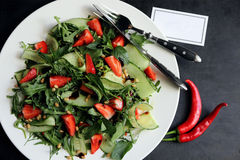Spicy salad of strawberries and cucumber Royalty Free Stock Photo