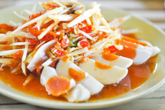 Spicy salad or Thai spicy salad som tam. Papaya salad or Thai spicy salad som tam Stock Photo