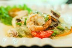 Spicy Salad thaifood. Shrimp onion tomato squid noodles blur focusshrimp dish Royalty Free Stock Images