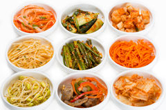 Spicy salads of traditional Korean cuisine. Soy sprouts, bamboo shoots, chicken ventricles, chimchi, raw potatoes, carrots, boiled squid, cucumbers and Stock Photo