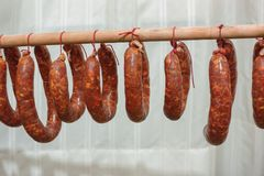Spicy salami hung to dry Basilicata Italy tradition. To understand a concept of food and industrialization Royalty Free Stock Photo