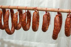 Spicy salami hung to dry Basilicata Italy tradition. To understand a concept of food and industrialization Stock Photography