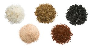 Spicy salt. Variety of natural and spicy salt on white background stock photo