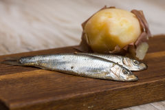 Spicy salted anchovies and boiled potatoes Stock Photo