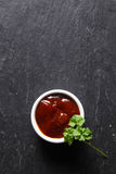 Spicy Sauce with Green Leaves on Wooden Table royalty free stock photos