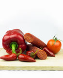 Spicy sausage with vegetables Stock Images