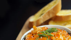 Spicy scallop with mayo cream together with garlic bread Stock Images