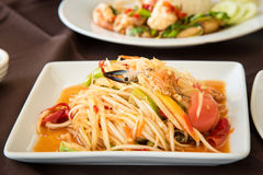 Spicy sea food papaya salad & x28;SOM TAM THAI& x29; Thai Cuisine in white. Plate in a white dish for lunch Stock Image