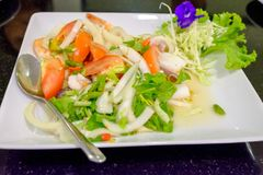 Spicy seafood combination put the tomatoes and onions. Are in the dish Royalty Free Stock Photography
