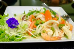 Spicy seafood combination put the tomatoes and onions. Are in the dish Royalty Free Stock Image