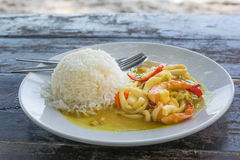 Spicy Seafood curry and Rice served on Dish Stock Photo