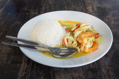 Spicy Seafood curry and Rice served on Dish Royalty Free Stock Images