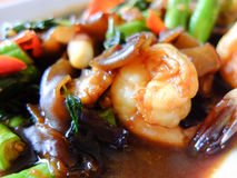 Spicy seafood fried basil on the plate Royalty Free Stock Photos