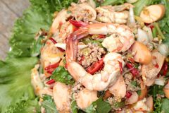 Spicy seafood noodle with green leafy vegetables. Royalty Free Stock Photos