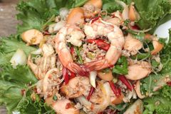 Spicy seafood noodle with green leafy vegetables. Stock Photos
