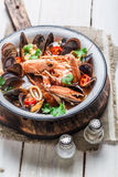 Spicy seafood soup with mussels and shrimps Stock Images