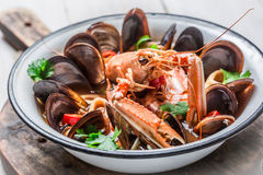 Spicy seafood soup with shrimps and mussels Royalty Free Stock Photos