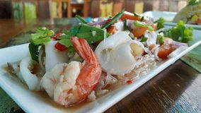 Spicy Seafood and vermicelli salad. Thai food: Seafood and vermicelli spicy salad Royalty Free Stock Images