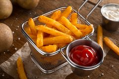Spicy Seasoned French Fries. Delicious crispy seasoned french fries with ketchup and mayonnaise Stock Images