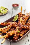 Spicy seasoned grilled or barbecued satay skewers stock photos