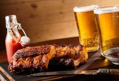 Spicy seasoned grilled spare ribs with beer stock images