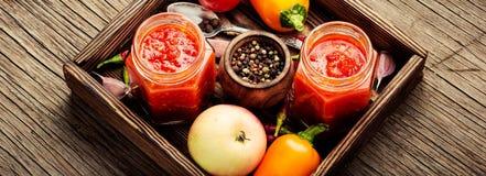 Spicy seasoning, sauce. Adjika, Abkhazian and Georgian spicy seasonings from red pepper, tomato and garlic Royalty Free Stock Photography