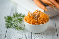Spicy sesame carrot noodles salad ready-to-eat overhead. Vegetable carrot with chia seeds, sesame, fresh carrots.  Clean eating,. Raw vegetarian food concept royalty free stock photography