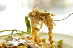 Spicy shredded bamboo shoot salad in Thai northeastern style scooping on fork Royalty Free Stock Photos