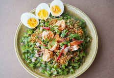Spicy Shrimp and betel nuts salad. Asia-Asian eating food, Thai foof, Yum Tua Poo: Spicy Shrimp and betel nuts salad or Winged bean salsa, with boil eggs, close Royalty Free Stock Photos