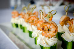 Spicy shrimp with cucumber and cream cheese skewers served on plate Royalty Free Stock Photos
