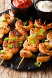 Spicy shrimp kebab with pineapples served with two sauces close stock image