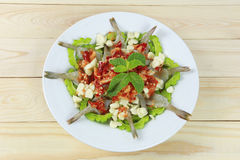 Spicy shrimp salad with fish sauce in white dish. Stock Photo