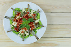 Spicy shrimp salad with fish sauce in white dish. Stock Photos
