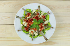 Spicy shrimp salad with fish sauce in white dish. Royalty Free Stock Image