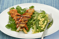 Spicy shrimp skewers with beans and corn Royalty Free Stock Photos