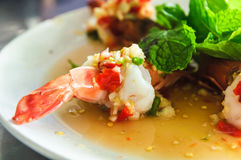 Spicy Shrimp steamed with lemon salad. Spicy Prawn or Shrimp steamed with lemon salads and mint on top, Thai Food Royalty Free Stock Photo