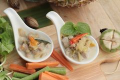 Spicy simmer pineapple with pork and vegetables. Stock Images